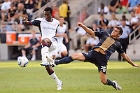 Kenny Mansally (7) of the New England Revolution plays the ball as Cristian Arrieta (26) of the Philadelphia Union defends. The Philadelphia Union and the New England Revolution  played to a 1-1 tie during a Major League Soccer (MLS) match at PPL Park in Chester, PA, on July 31, 2010.