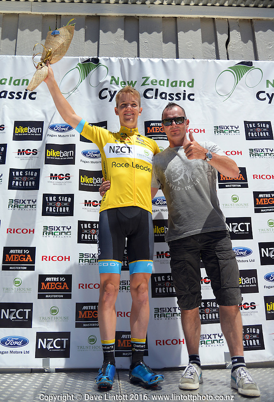 Tour leader Ryan Thomas (Data#3 Cisco Racing Team Australia) with the yellow jersey, presented by Superbike legend Aaron Slight (right), at the end of day three of the UCI Oceania Tour - NZ Cycle Classic stage three - Carterton circuit in Wairarapa, New Zealand on Friday, 22 January 2016. Photo: Dave Lintott / lintottphoto.co.nz