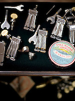 A sampling of Jim Mills' banjo hardware-picks, tuners, tailpieces, and strings.