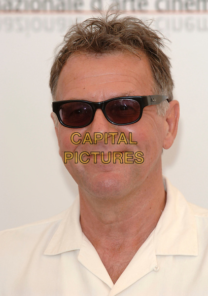 "TOM WILKINSON.At the photocall for the film ""The Exorcism of Emily Rose"".62nd INternational Film Festival,.Venice, 1st September 2005.portrait headshot sunglasses ray ban.Ref: PL.portrait headshot.www.capitalpictures.com.sales@capitalpictures.com.©Capital Pictures."