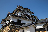 Hikone Castle - Hikone-jo  was completed in 1622 after 20 years of construction using some materials from nearby Nagahama Castle which was torn down. Hikone Castle was finally finished by Ii Naokatsu.  The Ii family remained allies of the ruling Tokugawa throughout the Edo Period.  Hikone Castle is an ornate black and white fortress and was the base of the local Ii familydaimyofeudal lord of the area. The top of the keep has wonderful views on a clear day over the surrounding countryside. Hikone-jo retains its original buildings, unlike many Japanese castles that have been rebuilt, and thus it is now shortlisted as a UNESCO World Heritage site.