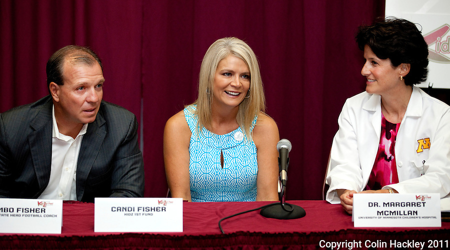 TALLAHASSEE, FLA. 8/4/11-FISHER080511 CH-Florida State University Head Football Coach Jimbo Fisher, left, is joined by wife Candi and leading Fanconi anemia researcher Dr. Margaret MacMillan, right, as they talk about the rare blood disorder afflicting their six-year-old son Ethan, Friday during a news conference in Tallahassee. While Ethan Fisher is healthy now, MacMillian anticipates he will need a bone marrow transplant in the future to combat the disease. The Fishers announced the creation of the Kidz 1st Fund to raise money to fund research to find a cure for the illness..COLIN HACKLEY PHOTO