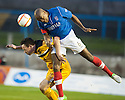 Cowdenbeath's Joe Mbu gets above Dumbarton's Jim Lister  ...