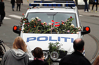 (Oslo July 25, 2011) A police car decorated with flowers. An estimated 150,000 people gathered in Oslo town centre for a vigil following Friday's twin extremist attacks ...A large vehicle bomb was detonated near the offices of Norwegian Prime Minister Jens Stoltenberg on 22 July 2011. .Another terrorist attack took place shortly afterwards, where a man killed 68 people, mainly children and youths attending a political camp at Utøya island. ..Anders Behring Breivik was arrested on the island and has admitted to carrying out both attacks..(photo:Fredrik Naumann/Felix Features)