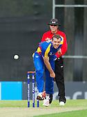 ICC World T20 Qualifier (Warm up match) - Scotland V Namibia at Grange CC, Edinburgh - Namibia bowler Sarel Burger bowls past Umpire Ian Ramage — credit @ICC/Donald MacLeod - 06.7.15 - 07702 319 738 -clanmacleod@btinternet.com - www.donald-macleod.com