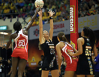 09.07.2011 Silver Ferns Irene Van Dyk in action during the netball match between Silver Ferns and England at the Mission Foods World Netball Championship 2011 held at the Singapore Indoor Stadium in Singapore . Mandatory Photo Credit ©Michael Bradley.