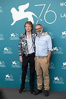 """VENICE, ITALY - SEPTEMBER 07: Mick Jagger and director Giuseppe Capotondi at """"The Burnt Orange Heresy"""" photocall during the 76th Venice Film Festival at Sala Grande on September 07, 2019 in Venice, Italy. <br /> CAP/GOL<br /> ©GOL/Capital Pictures"""