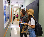 Rui Wang and Zhiqing Hu check out the posters detailing the research their classmates are conducting in UM's National Center for Natural Products Research. Photo by Robert Jordan/Ole Miss Communications