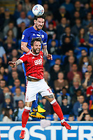Sean Morrison of Cardiff City wins the header as he contends with Danny Fox of Nottingham Forest during the Sky Bet Championship match between Cardiff City and Nottingham Forest at the Cardiff City Stadium, Wales, UK. Saturday 21 April 2018