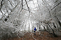 27/01/17<br />  <br /> A walker explores woodland after temperatures plunged to minus four degrees celsius last night leaving frozen fog clinging to trees - the phenomenon, which is NOT snow is known as hoar frost and was spotted on Mam Tor near near Castleton in the Derbyshire Peak District this morning.<br /> All Rights Reserved F Stop Press Ltd. (0)1773 550665 www.fstoppress.com