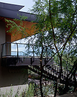 The property is approached by a steep set of steps while bedrooms and services are housed on the lower floor