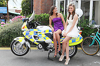 5/8/2010.Blossom Hill Ladies Day. Sisters Chloe and Geraldine Carton from Dublin are pictured siting on a Garda bike at the Blossom Hill Ladies Day at the Fáilte Ireland Dublin Horse Show at RDS. Picture James Horan/Collins Photos
