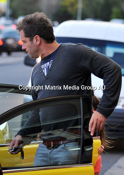 11 AUGUST 2013 SYDNEY AUSTRALIA<br /> <br /> EXCLUSIVE PICTURES<br /> <br /> Karl Stefanovic pictured looking casual in UGG boots as he steps out for a chicken dinner picked up from the local KFC with his daughter. Karl completed his 'bogan' appearance with his new chariot a yellow Holden HSV commodore.