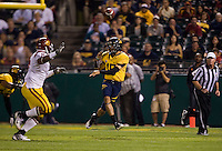 October 13th, 2011:  Zach Maynard of California throws the ball to his open receiver during a game against USC at AT&T Park in San Francisco, Ca  -  USC defeated California 30 - 9