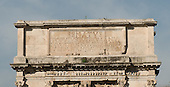 """The Arch of Titus, located on the Via Sacra, just to the south-east of the Roman Forum in Rome, Italy, which was built to commemorate Titus's victory in Judea, depicts a Roman victory procession with soldiers carrying spoils from the Temple, including the Menorah, which were used to fund the construction of the Colosseum, on Wednesday, October 23, 2013.  The arch was constructed c. 82 AD by the Roman Emperor Domitian shortly after the death of his older brother Titus to commemorate Titus' victories, including the Siege of Jerusalem in 70 AD. The Arch is said to have provided the general model for many of the triumphal arches erected since the 16th century—perhaps most famously it is the inspiration for the 1806 Arc de Triomphe in Paris, France, completed in 1836. The inscription reads """"The Roman Senate and People (dedicate this) to the divine Titus Vespasianus Augustus, son of the divine Vespasian.""""<br /> Credit: Ron Sachs / CNP"""