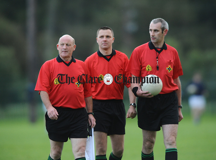 Referees Kevin Walsh, Rory Hickey and Gerry Keane during the group 4 game at Shannon. Photograph by John Kelly.