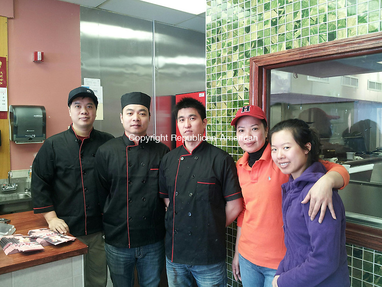 TORRINGTON, CT- 12 February 2014- 021214BJ02-- Workers and the owner of Hibachi Express pose for a photo at Hibachi Express, a new Japanese and Chinese restaurant on High Street. From left to right are Johnny Lee, Paul Lin, Kevin Chen, owner Lan Zhen Li, and Kimmie Cheng. Bruno Matarazzo Jr. Republican-American