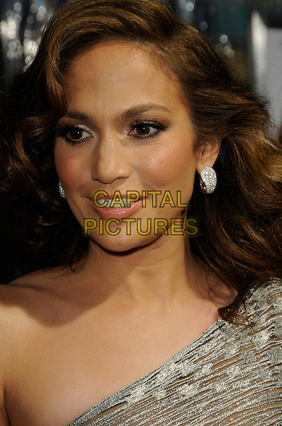 """JENNIFER LOPEZ .arriving at the premiere of CBS Films' """"The Back-up Plan"""" at the Regency Village Theatre in Westwood, California, USA, April 21st, 2010..arrivals portrait headshot one shoulder silver earrings wavy hair mouth open .CAP/ROT.©Lee Roth/Capital Pictures"""