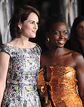 Michelle Dockery and Lupita Nyong'o attends Universal Pictures' Non-Stop held at Regency Village Theatre in Westwood, California on February 24,2014                                                                               © 2014 Hollywood Press Agency