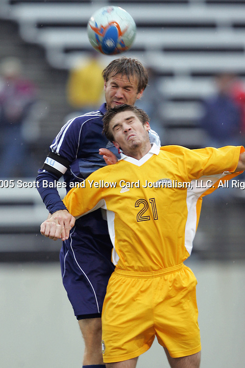 27 November 2005: SMU's Jay Needham (behind) jumps over UNC-G's Michael FitzGerald (21) for a header. Southern Methodist University defeated the University of North Carolina at Greensboro 3-1 at UNC-G Soccer Stadium in Greensboro, North Carolina in a 2005 NCAA Men's Soccer Tournament game.