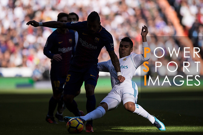Jose Paulo Bezerra Maciel Junior, Paulinho (2nd R), of FC Barcelona fights for the ball with Carlos Henrique Casemiro (R) of Real Madrid during the La Liga 2017-18 match between Real Madrid and FC Barcelona at Santiago Bernabeu Stadium on December 23 2017 in Madrid, Spain. Photo by Diego Gonzalez / Power Sport Images