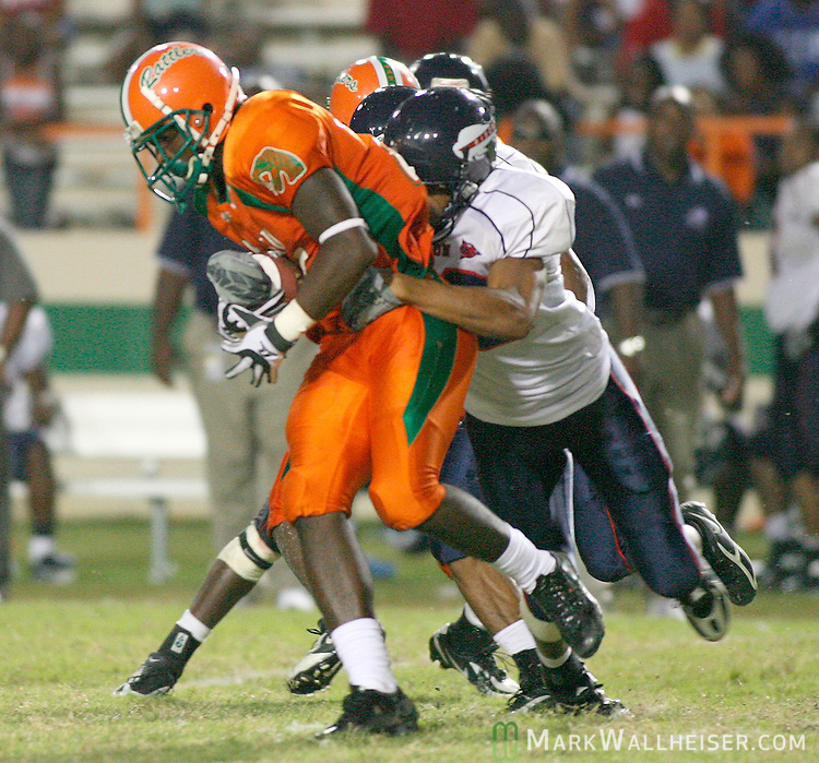 Howard's Martin Corniffe, right, strips the ball from FAMU's Rafael Gray on the ensuing kick off in the 2nd half of the FAMU vs Howard football game at Bragg Stadium September 15, 2007.  (Mark Wallheiser/TallahasseeStock.com)