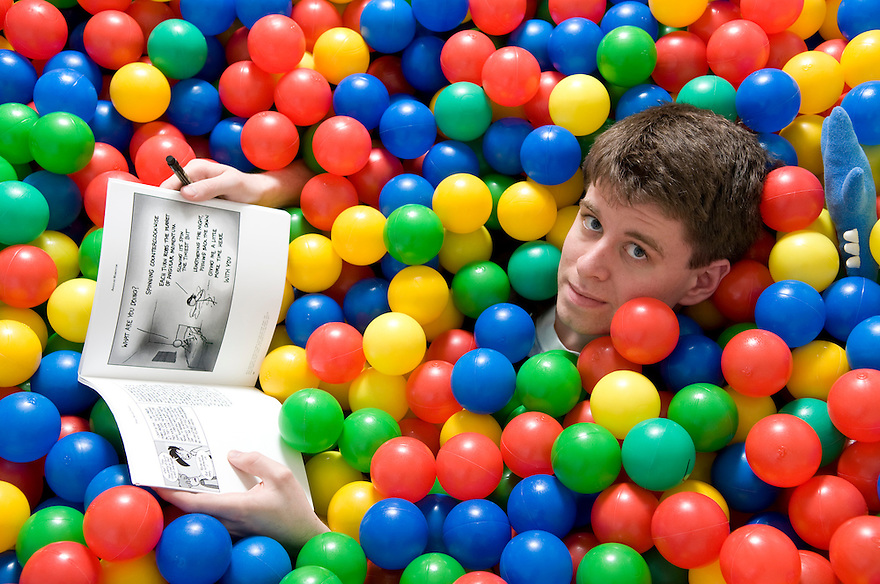 SOMERVILLE, MA.--April 16, 2009--Randall Munroe, creator of xkcd, a hugely popular online comic strip, at home in his playpen ball pen. Mr. Munroe has a new book coming out titled xkcd. CREDIT: JODI HILTON FOR THE NEW YORK TIMES