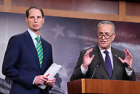 United States Senate Minority Leader Chuck Schumer (Democrat of New York) and US Senator Ron Wyden (Democrat of Oregon), the ranking member of the US Senate Finance Committee meet reporters in the US Capitol in Washington, DC to denounce the new tax plan announced by US President Donald J. Trump and House and Senate Republicans as tax cuts for the wealthy on Wednesday, September 27, 2017. PhotoCredit: Ron Sachs/CNP/AdMedia