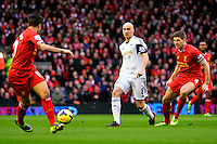 Sunday, 23 February 2014<br /> Pictured: Swansea City's Jonjo Shelvey and Liverpool's Steven Gerrard compete<br /> Re: Barclay's Premier League, Liverpool FC v Swansea City FC v at Anfield Stadium, Liverpool Merseyside, UK.