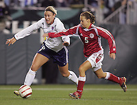 06 November,  2004. USWNT forward Abby Wambach (16) tries to keep Denmark's Bettina Falk (5) away from the ball at  Lincoln Financial Field in Philadelphia, Pa.