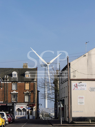 Lowestoft, Suffolk, England. Wind turbine between houses on High Street.
