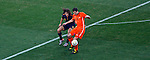 Netherlands Robin Van Persie controls the ball infront of Carlos Puyol during 2010 FIFA World Cup final match, Netherlands vs Spain, Johannesburg, South Africa, Sunday, July, 11, 2010. , Soccer City Stadium (credit & photo: Pedja Milosavljevic / +381 64 1260 959 / thepedja@gmail.com / STARSPORT )