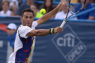 Washington, DC - August 5, 2015: Victor Estrella Burgos of the Dominican Republic makes a backhand shot in a match against John Isner of the USA during the Citi Open tennis tournament at the FitzGerald Tennis Center in the District of Columbia August 5, 2015.  (Photo by Don Baxter/Media Images International)