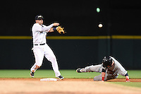 Lakeland Flying Tigers second baseman Brandon Loy (10) attempts to turn a double play as first baseman Garrett Cooper (31) slides in during a game against the Brevard County Manatees on April 10, 2014 at Joker Marchant Stadium in Lakeland, Florida.  Lakeland defeated Brevard County 6-5.  (Mike Janes/Four Seam Images)