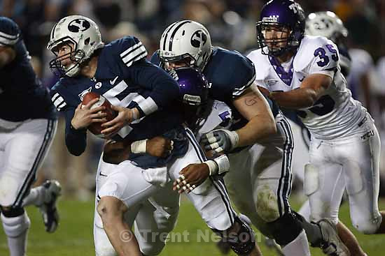 BYU's QB Max Hall (15) is sacked by TCU's Cory Grant (57). BYU vs. TCU college football Saturday, October 24 2009 in Provo.