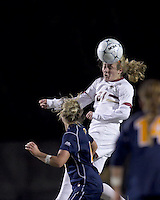 "Boston College midfielder Kate McCarthy (21) heads the ball. Boston College defeated West Virginia, 4-0, in NCAA tournament ""Sweet 16"" match at Newton Soccer Field, Newton, MA."