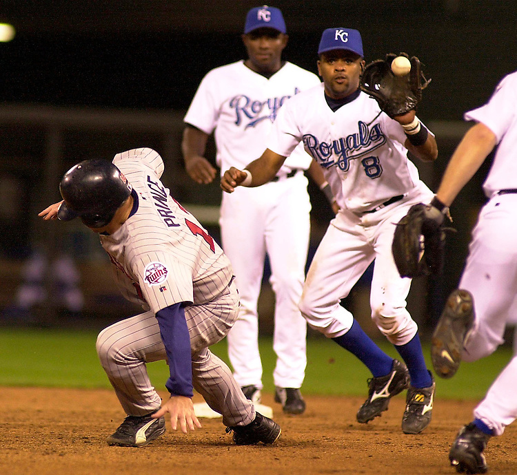 Royals short stop Neifi Perez and third baseman Joe Randa gets Twins catcher Tom Prince in a run down between second and third base in the ninth inning at Kauffman Stadium in Kansas City, Missouri on May 13, 2002.  Prince was tagged out by pitcher Brian Shouse.  Minnesota won 3-2.