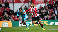 Bryan Mbeumo outpaces Luton goalkeeper, James Shea, to score Brentford's opening goal during Brentford vs Luton Town, Sky Bet EFL Championship Football at Griffin Park on 30th November 2019