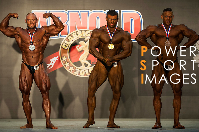 (L-R) Geiwagher Stephan of Germany, Sazonov Mikhail of Russia and Benson Milgate of Australia pose for photos during the Arnold Classic Asia Multi-Sport Festival on 20 August 2016 at the AsiaWorld-Expo, Hong Kong. Photo by Marcio Machado / Power Sport Images