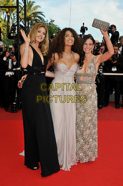 Doutzen Kroes, Afef Jnifen, Evangeline Lilly.'Vengance' screening.62nd International Cannes Film Festival.Cannes, France. 17th May 2009.full length black slit split dress grey gray strapless cleavage thigh leg clutch bag silver patterned hand waving .CAP/PL.©Phil Loftus/Capital Pictures