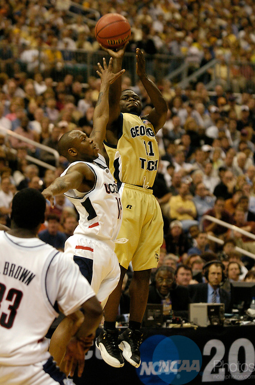 5 APR 2004: Georgia Tech guard Will Bynum (#11) goes up for a jump shot during the Division I Men's Basketball championship game held at the Alamodome in San Antonio, TX. The University of Connecticut defeated Georgia Tech 82-73 for the championship title. Ryan McKee/NCAA Photos