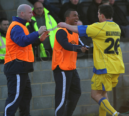 20/03/2010. Barrow forward Gregg Blundell celebrates scoring the only goal of the game with Barrow substitutes Lee McEvilly (left) and Carlos Logan (centre). FA Trophy Semi Final First Leg - Salisbury City v AFC Barrow Town at Salisbury, Wiltshire, England, UK.