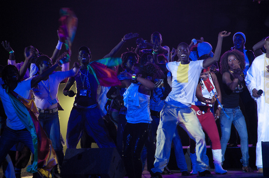 Dakar, Senegal - December 10 -Youth dance while Senegalese singer Ismael Lo (far right) performs at the youth evening event during the first night of the World Festival of Black Arts and Cultures taking place in Dakar, Senegal from December 10 to 31. The festival has brought singers, dancers, artists, writers and more from around the world to celebrate African artists, as well as the diaspora's cultural achievements.