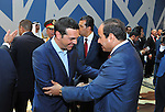 Egyptian President, Abdel Fattah al-Sisi, shakes hands with the Greek Prime Minister, Alexis Tsipras following the inauguration ceremony for the new additions to the Suez Canal, Egypt, 06 August 2015. The latest addition to the canal comes in at 35 kilometers of new canal and the widening of a further 37 kilometers of old canal, was completed in under a year, with an estimated cost of 8.5 billion US dollars once additional projects are completed, and was opened to shipping 06 August. According to the Egyptian Government the additional chanel cuts journey times from an estimated 18-14 hours to 11 hours, making it the fastest shipping lane of its kind worldwide, and will double revenue by 2023, though their figures have been widely disputed by international economists. Photo by Egyptian President Office