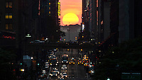 "Sunset is seen during the annual phenomenon known as ""Manhattanhenge,"" when the sun aligns perfectly with the city's transit gridin New York May 29, 2013 by Kena Betancur / VIEWpress"