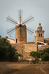 Traditional stone tower windmill and church tower, Algaida, Mallorca