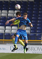Sean Kelly challenges Liam Polworth in the air in the Inverness Caledonian Thistle v St Mirren Scottish Professional Football League Premiership match played at the Tulloch Caledonian Stadium, Inverness on 29.3.14.