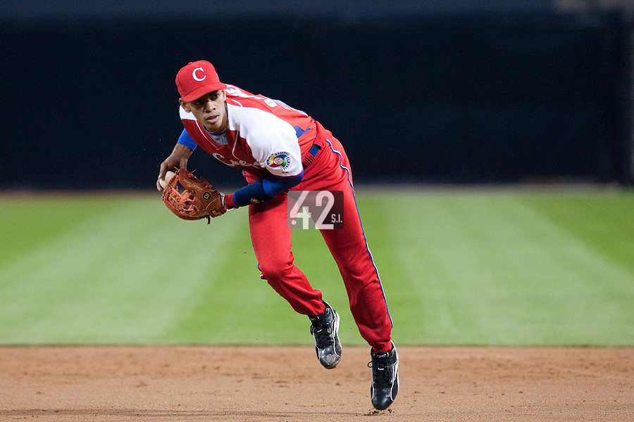 16 March 2009: #28 Hector Olivera is seen during infield practice prior to the 2009 World Baseball Classic Pool 1 game 3 at Petco Park in San Diego, California, USA. Cuba wins 7-4 over Mexico.