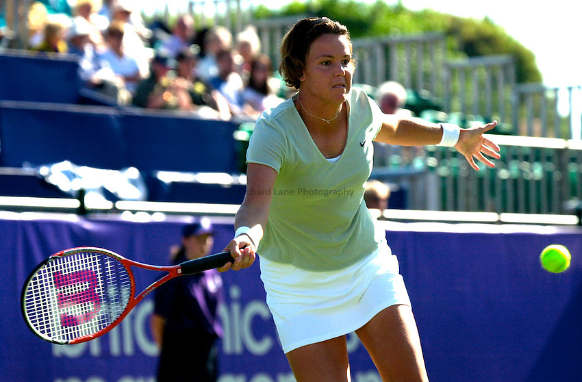 Photo. Rene Solari..19/6/01  .Eastbourne Day 2. American Lindsay Davenport puts pressure on Frence Anne-Gaelle Sidot as she is eager to win her 1st competitive match since injury....
