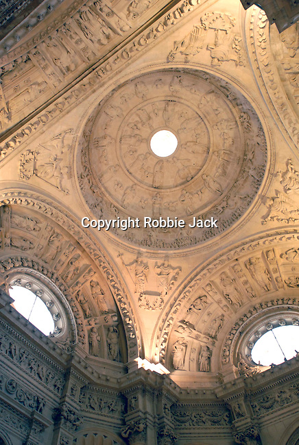 Ceiling in the Cathedral of Saint Mary of the See  in Seville. It is the largest gothic cathedral in the world. It occupies the site of Hagia Sophia, a mosque built by the Almohads in the late 12th century. La Giralda, its bell tower, is a legacy from the Moorish structure.